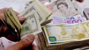 الدولار يحافظ على ارتفاعه في افتتاح  تعاملات الأحد