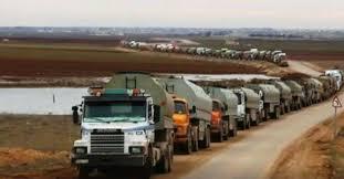 النظام يتهم أمريكا بسرقة رتل شاحنات نفط وإدخالها إلى العراق