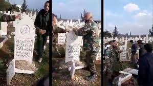 Russia honors militia leaders loyal to the Syrian regime, one of them exhuming the graves of the revolutionaries