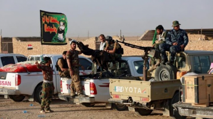 A delegation of the Revolutionary Guard enters Al-Bukamal from Iraqi territory