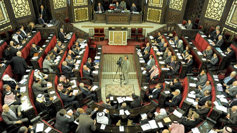 بمخالفة دستورية واضحة...نظام  الأسد يُعين عضوا في برلمانه   قائداً لإحدى ميليشياته بحلب