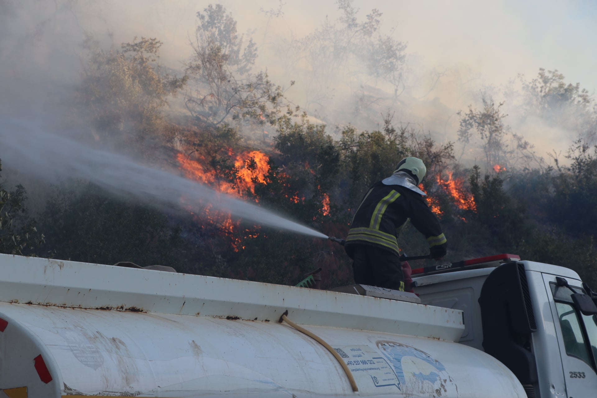 Civil Defense controls fires that broke out in the forested land in Afrin countryside